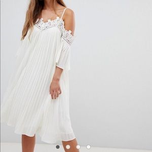 White dress can be worn as maternity